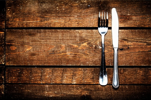 The Wisconsin options for food and drink on this table are endless.  Keep discovering!  [© Nataliazakharova | Dreamstime.com - Knife And Fork Over Wooden Table]
